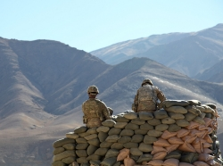 Two U.S. soldiers run communications equipment from a bunker in Wardak province, Afghanistan, January 9, 2011