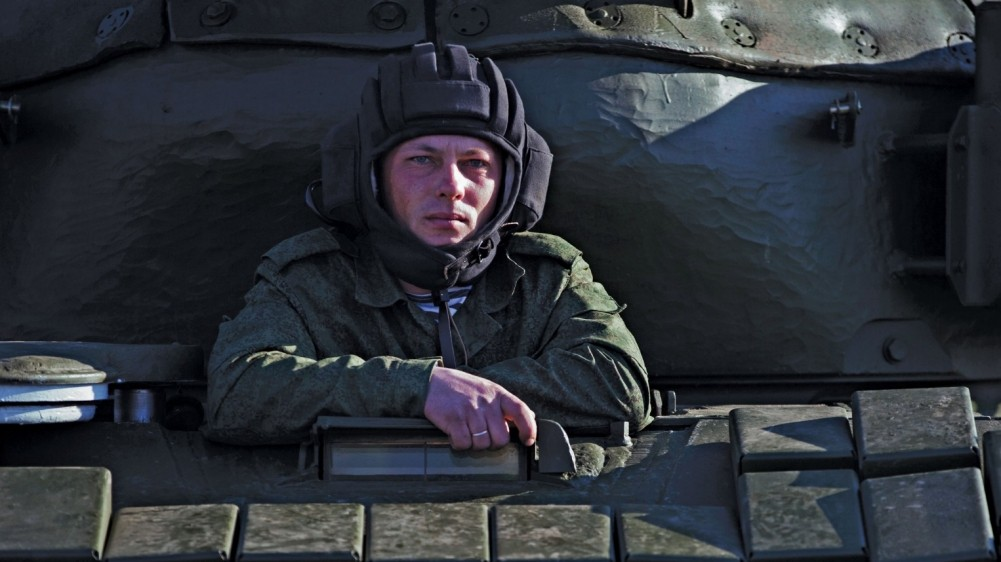 A Russian soldier sits in his tank