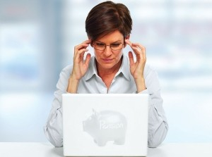 Woman with a laptop having a headache.