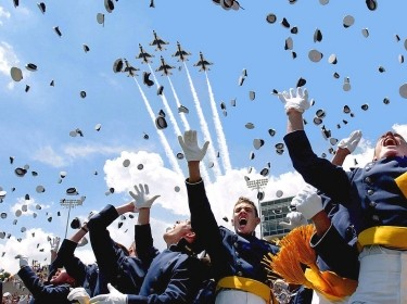 Cadets of the Air Force Academy Class of 2003 celebrate at graduation ceremonies on May 28, 2003 as the Air Force Thunderbirds fly overhead