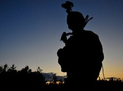 A 23rd Special Tactics Training Squadron student guards the perimeter in a counter-insurgency exercise