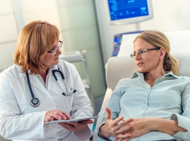 Female doctor consulting with patient in a hospital setting