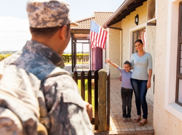 Mother and daughter welcome military father home