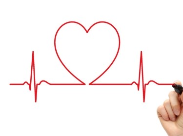 Hand drawing an ECG line with a heart in the middle