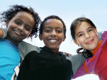 Three children smiling