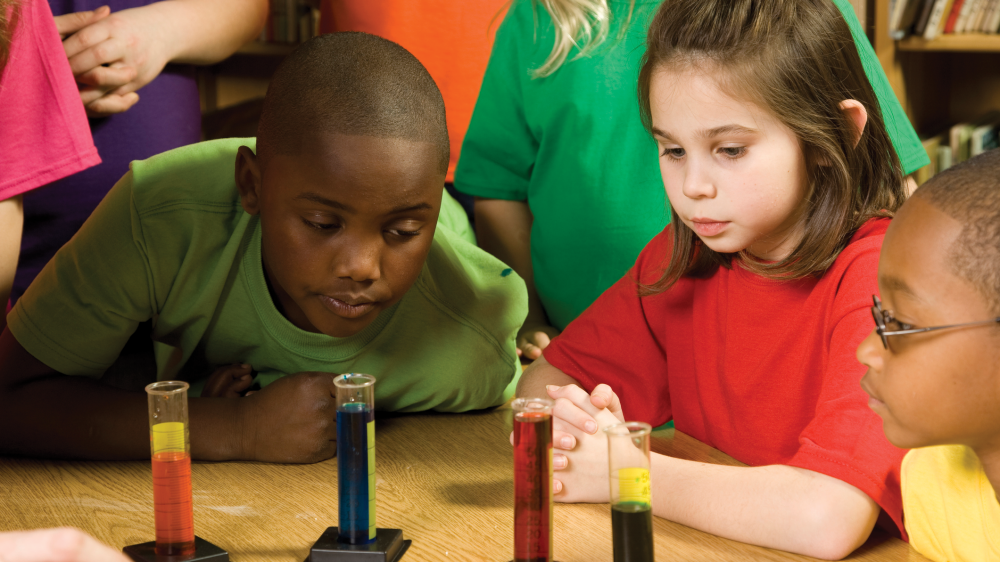 Children engage in an experiment