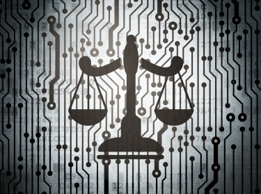 Illustration of the scales of justice with computer circuit board background