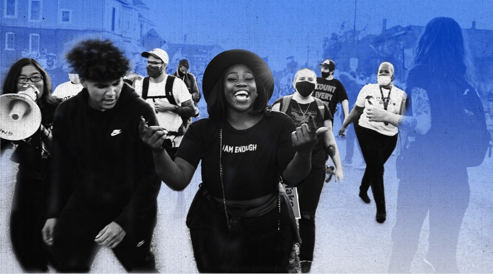 """A woman in a """"I am enough"""" t-shirt marches"""