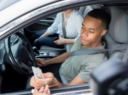 A young man is pulled over for speeding, photo by SDI Productions/Getty Images
