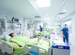 COVID-19 patients in an intensive care unit, photo by JazzIRT/Getty Images