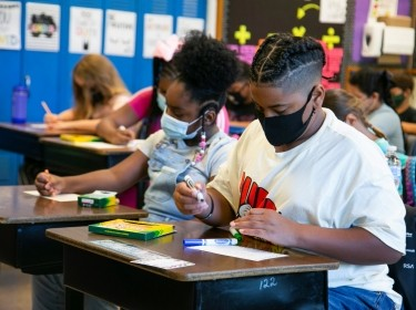 Students draw in class at Wilder Elementary School in Louisville, Kentucky, August 11, 2021, photo by Amira Karaoud/Reuters
