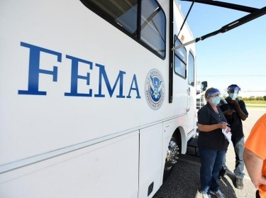 FEMA staff at a mobile center assist residents with registration and answer questions about disaster-assistance programs in the aftermath of Hurricane Sally, September 2020, photo by FEMA