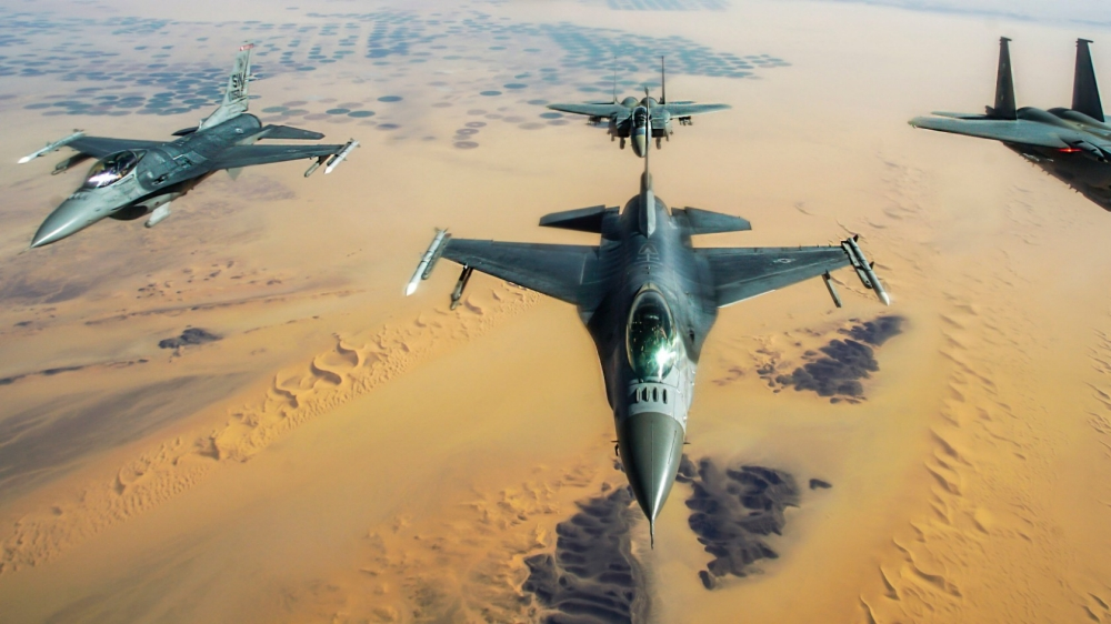 F-16 Fighting Falcons in formation with two Royal Saudi Air Force F-15E Strike Eagles, after receiving fuel from a KC-135R Stratotanker