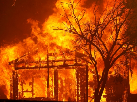 A house burning along Cherry Glen Road during the LNU Lightning Complex Fire on the outskirts of Vacaville, California, August 19, 2020, photo by Stephen Lam/Reuters