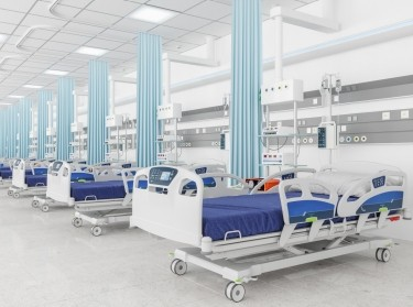 Empty beds in a hospital ward, photo by  onurdongel/Getty Images
