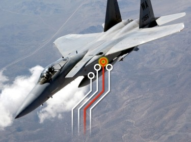 An F-15 flying over Nevada during a USAFWS Mission Employment Exercise