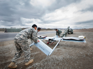 Service members train with the Shadow remotely piloted aircraft system, Feb. 6, 2014