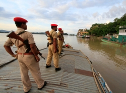 Indian security personnel on the Brahmaputra River in Guwahati, India, August 6, 2014
