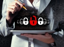 An information security illustration superimposed over a businesswoman holding a tablet