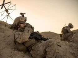 Marine Corps sergeant relays commands during a tactical exercise to recover aircraft and personnel at an undisclosed location in Southwest Asia, January 25, 2016