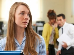 Woman being talked about in an office