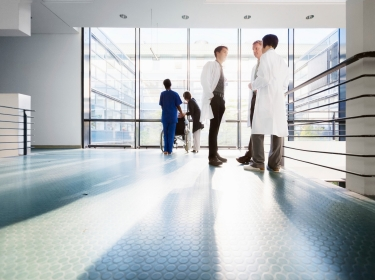 Group of doctors in a brightly lit hospital hallway