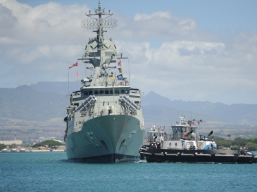 The Royal Australian Navy guided-missile frigate HMAS Perth arrives in Pearl Ha