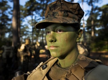 Pfc. Christina Fuentes Montenegro prepares to hike to her platoon's defensive position during patrol week of Infantry Training Battalion near Camp Geiger, N.C. in Oct. 2013