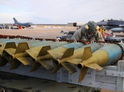 U.S. Air Force Staff Sgt. Antonio Diaz inspects munitions before they are mounted onto an F-16C Fighting Falcon during flightline operations Jan. 9, 2015, at Atlantic City Air National Guard Base, N.J.