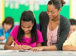 A teacher helping a student in class