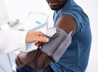 Doctor taking blood pressure of an African-American man