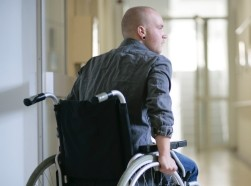 A young man in a wheelchair