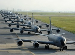 Twelve KC-135 Stratotankers from the 909th Air Refueling Squadron taxi onto the runway during exercise Forceful Tiger on Kadena Air Base, Japan, April 1, 2015