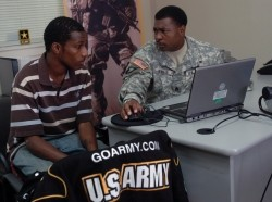 Staff Sgt. Roger L. Whaley speaks with a candidate at the U.S. Army Recruiting Station in Radcliff, Ky.