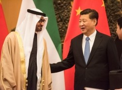 Sheikh Mohammed bin Zayed al-Nahyan, Crown Prince of Abu Dhabi and UAE's deputy commander-in-chief of the armed forces, meets Chinese President Xi Jinping in Beijing, December 14, 2015