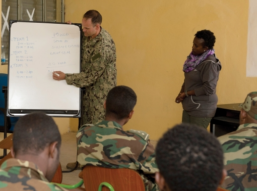 U.S. Navy LTJG Mike Gibson instructs the Ethiopian National Defense Force engineers on daily operations for engineering teams