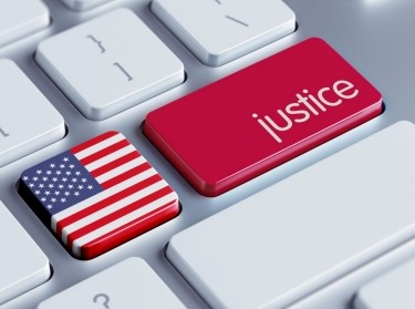 A keyboard with a justice button and U.S. flag
