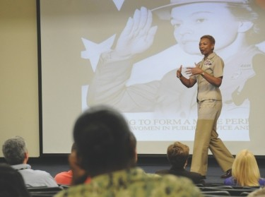 Master Chief April Beldo, fleet master chief for manpower, personnel, training and education (MPT&E), delivers remarks during a Women's History Month presentation at Navy Expeditionary Combat Command (NECC) at Joint Expeditionary Base Little Creek, photo by U.S. Navy photo by Mass Communication Specialist 3rd Class Lauren Booher/Released