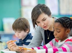 A teacher helping a student understand an assignment