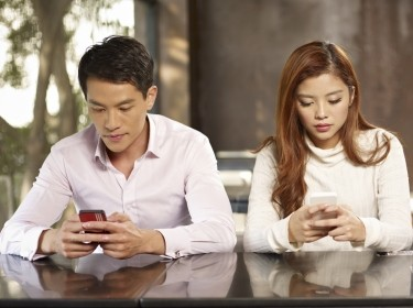 Three young people on smartphones