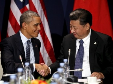 U.S. President Barack Obama shakes hands with Chinese President Xi Jinping at the start of the climate summit in Paris, November 30, 2015