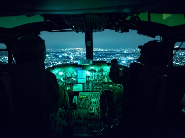Two U.S. Air Force pilots use night vision goggles during an exercise above Yokota Air Base, Japan, August 24, 2015