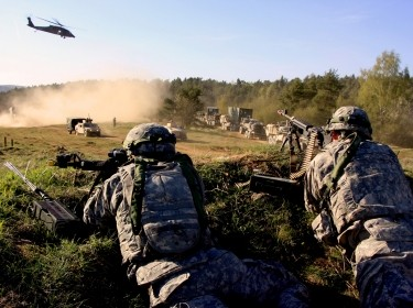 Supply sergeants for the 2nd Cavalry Regiment's field artillery troop defend a hilltop as a 16th Sustainment Brigade logistics supply column passes by during exercise Saber Junction 15