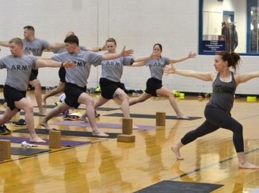 Army soldiers take a yoga class at Fort Campbell, Kentucky, April 23, 2015
