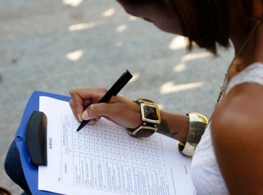 Woman filling out a survey