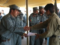 An Afghan Local Police recruit receives his certificate of completion on graduation day in Ghazni province, Afghanistan, September 26, 2013