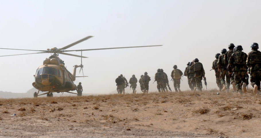 Afghan National Army commandos board an Afghan National Air Force MI-17 helicopter at a landing zone near Camp Lawton, in Herat province, Afghanistan