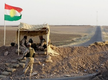 Kurdish Peshmerga troops are deployed in the area near the northern Iraqi border with Syria, August 6, 2012