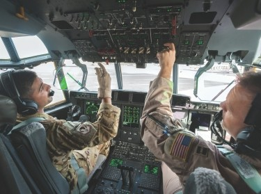 U.S. Air Force pilots conduct pre-flight checklists at Leopold Sedar Senghor International Airport in Dakar, Senegal, November 4, 2014