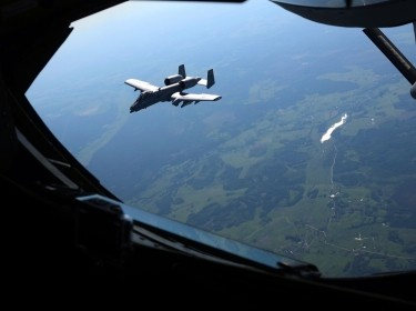 An A-10C Thunderbolt II flies near a KC-135 Stratotanker after departing from Amari Air Base, Estonia, during an exercise with the Estonian Air Force and Maryland Air National Guard, June 3, 2013